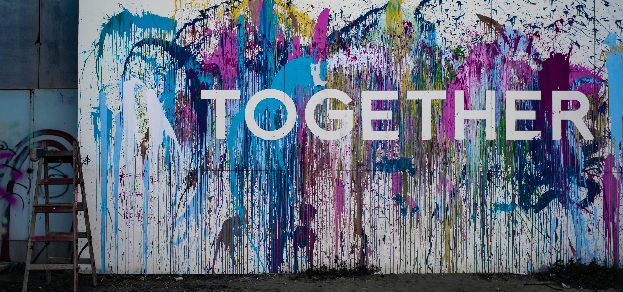 "Canvas with the word ""Together"" on a splatter paint background"